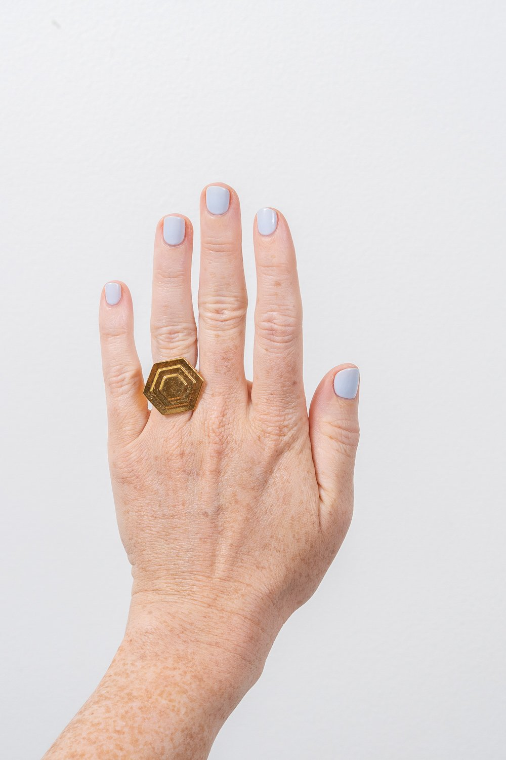 Art Deco gold hexagon ring on hand