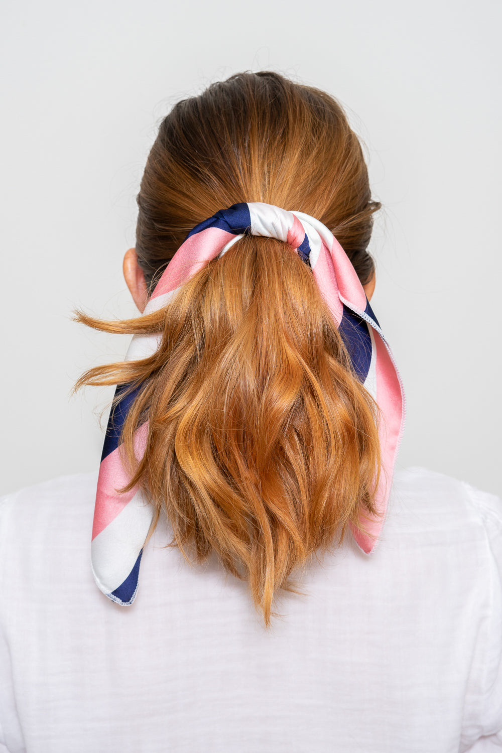 red head with pink navy white hair scarf tied in hair ponytail hoop earrings Janna Conne