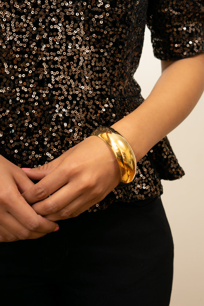 gold dome bangle bracelet on model