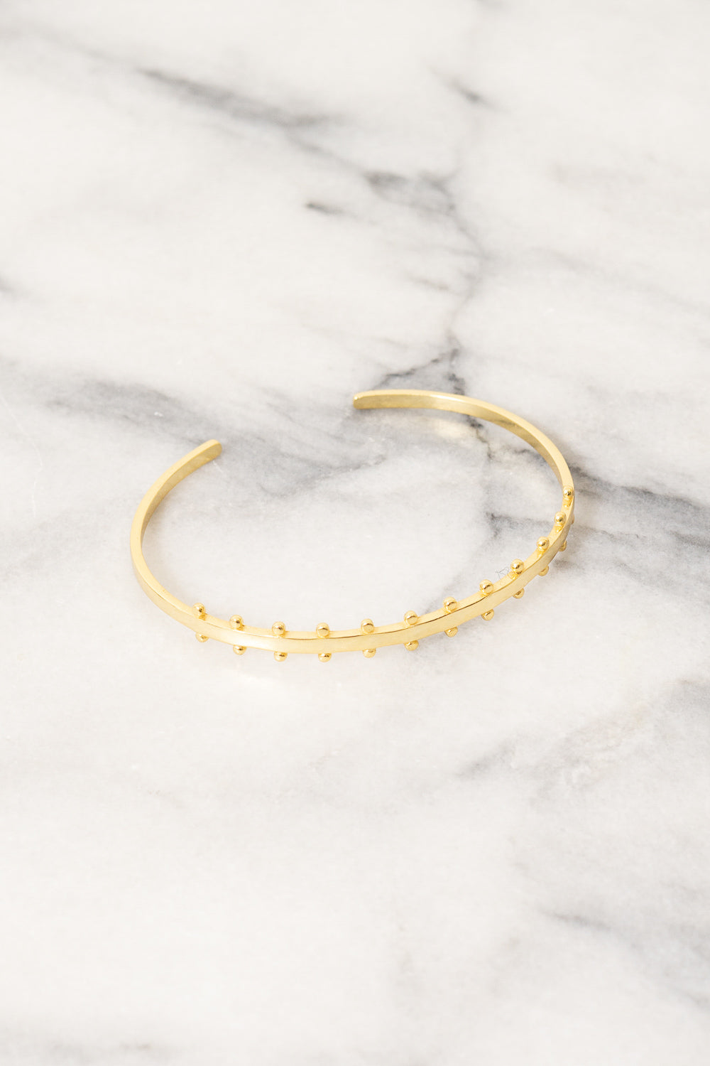 vermeil gold cuff bracelet with studs by Janna Conner