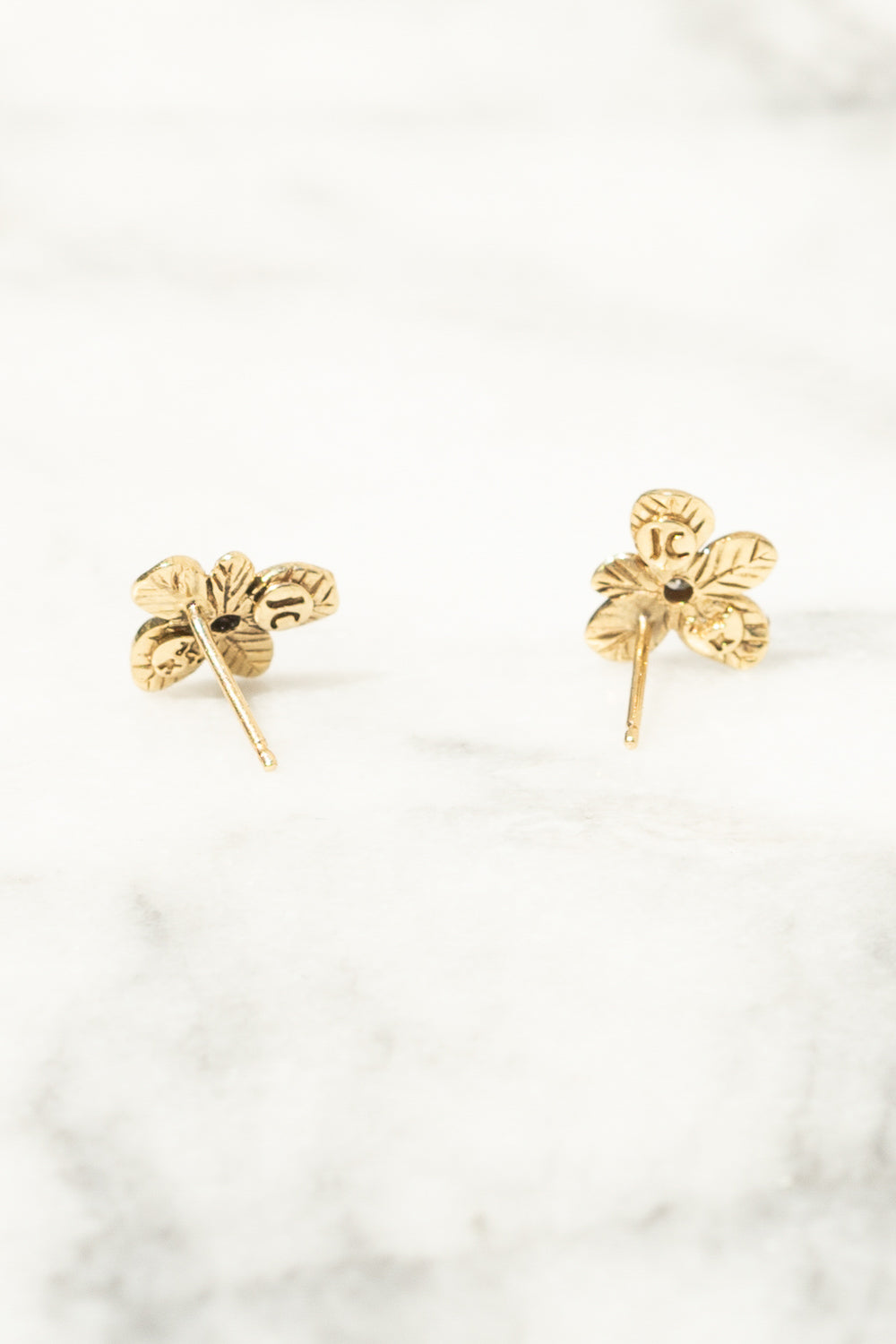 back view of gold flower stud earrings