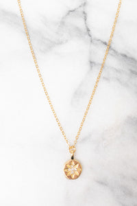 gold starburst pendant necklace