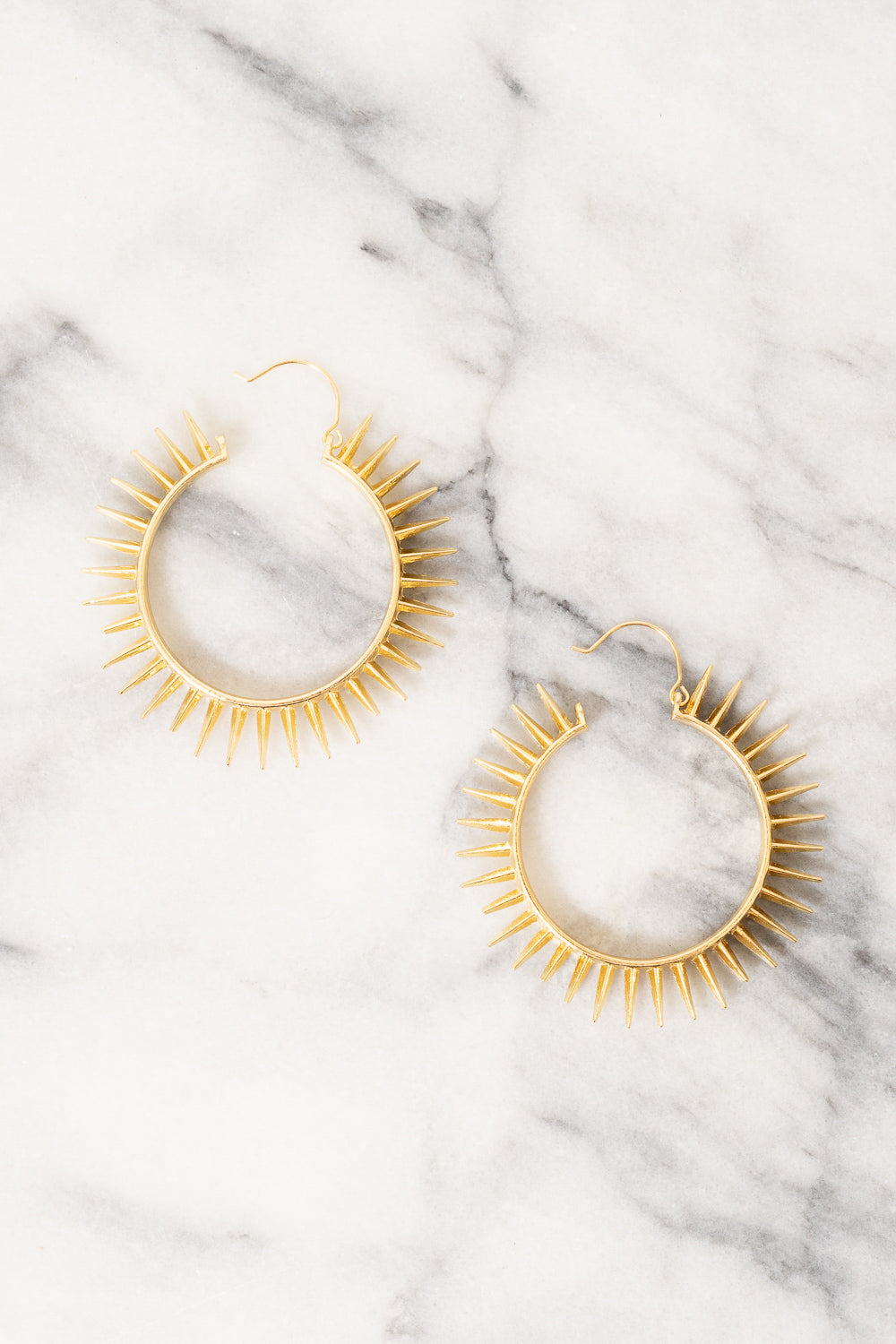 large gold spike basket hoop earrings
