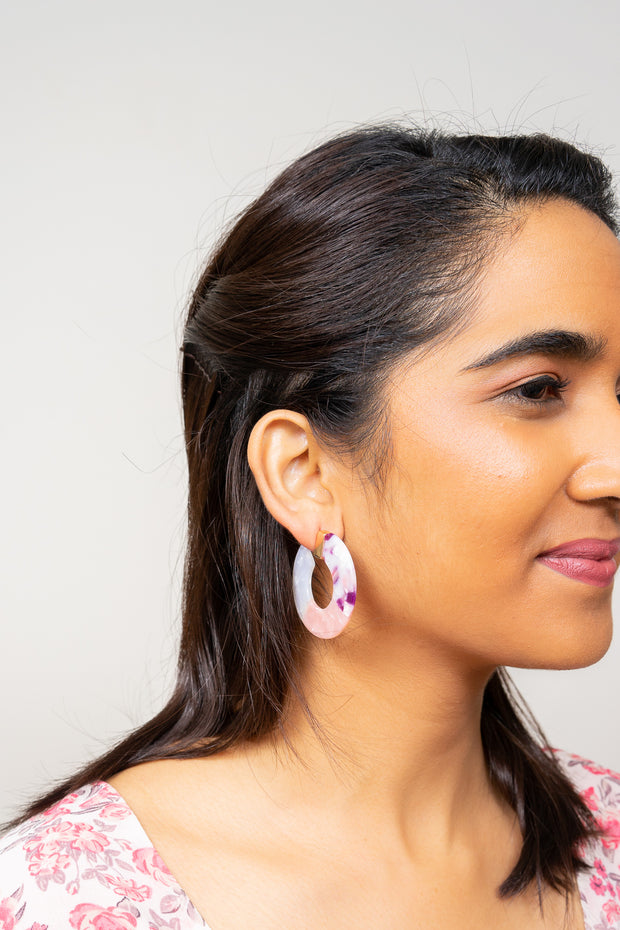 purple pink ombre acrylic hoop earrings on model
