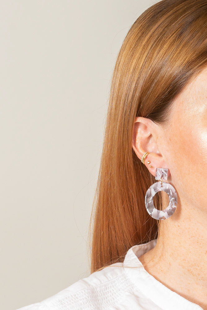 grey marble acrylic dangle earrings on model