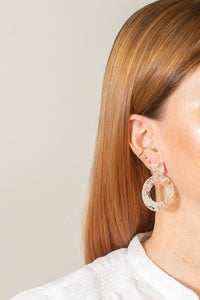 caramel blonde acrylic dangle earrings on model