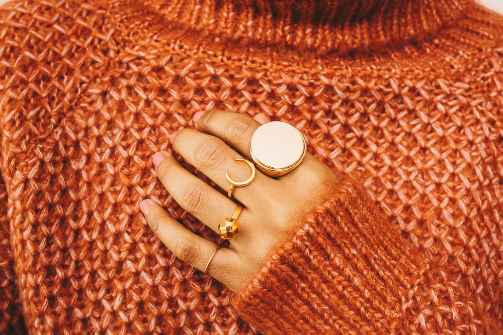 gold stacking rings gold signet ring on hand
