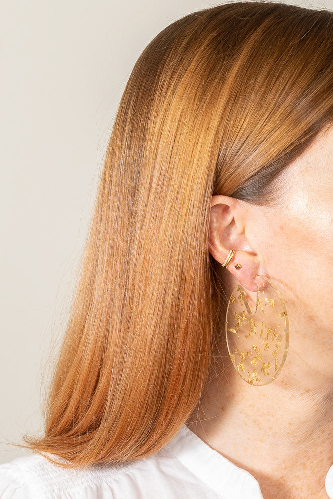 gold leaf flake clear acrylic disc earrings on model sideview