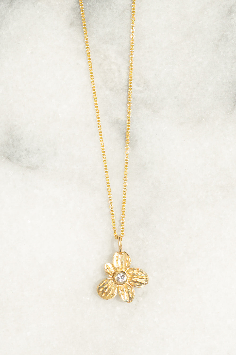 gold flower charm necklace white sapphire