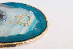 gold stacking rings on agate slice