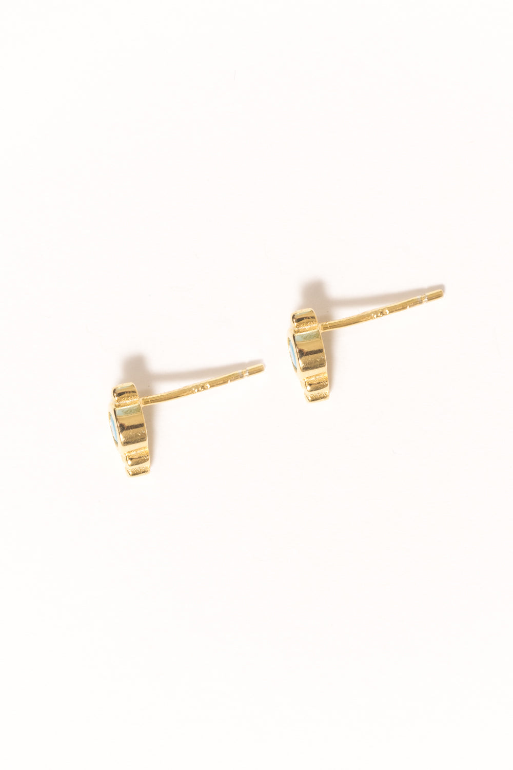 side view of blue opal tiny vermeil stud earrings