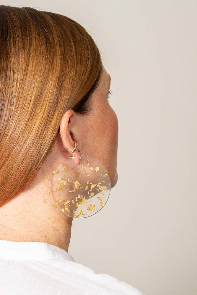 gold leaf flake clear acrylic disc earrings on model