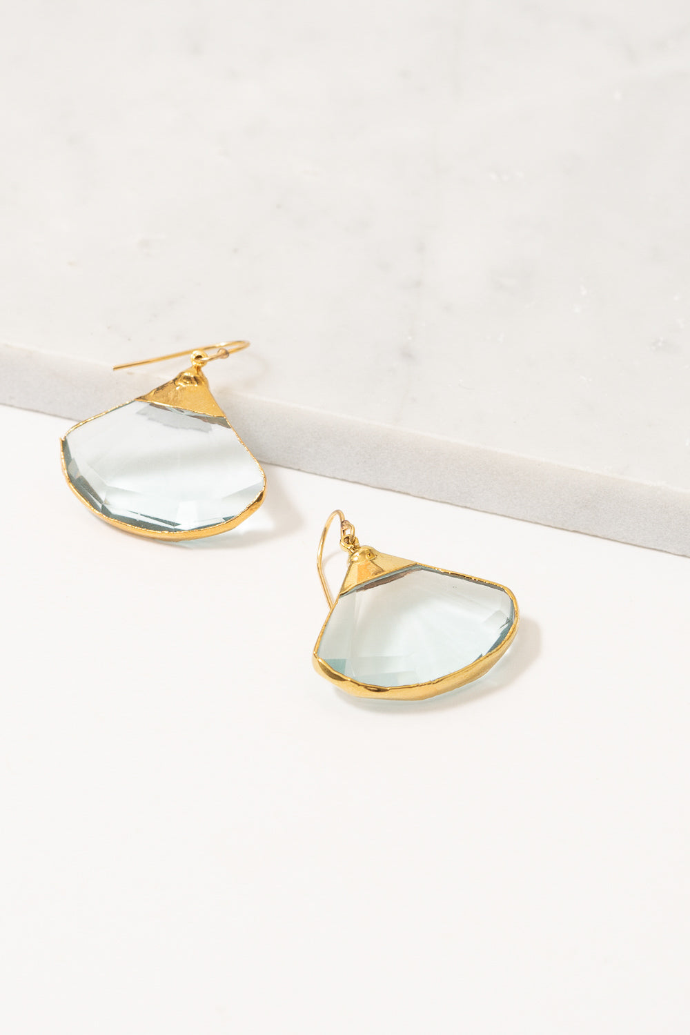 fan shaped earrings light blue quartz on marble