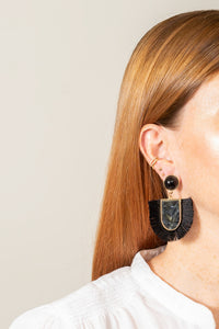 black acrylic fringe earrings on model