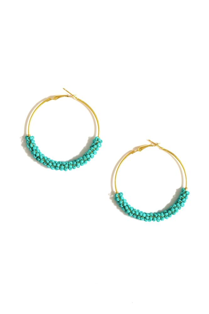 turquoise beaded hoop earrings by janna Conner on white background
