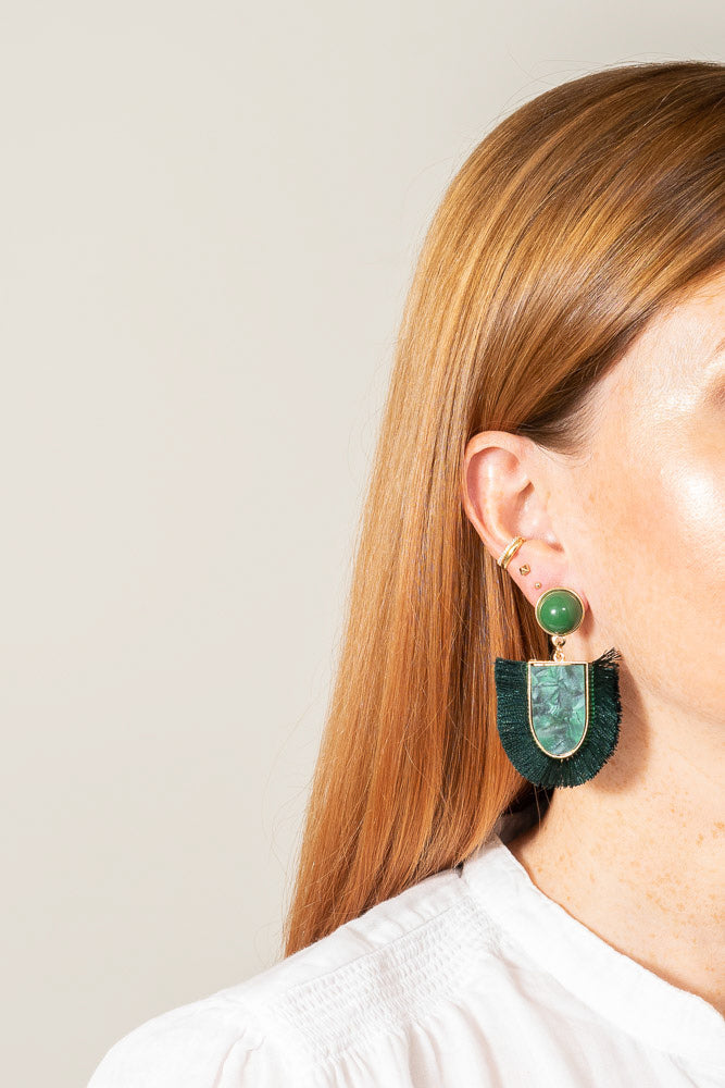 green acrylic fringe earrings on model