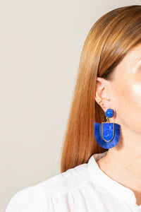 blue acrylic fringe earrings on model