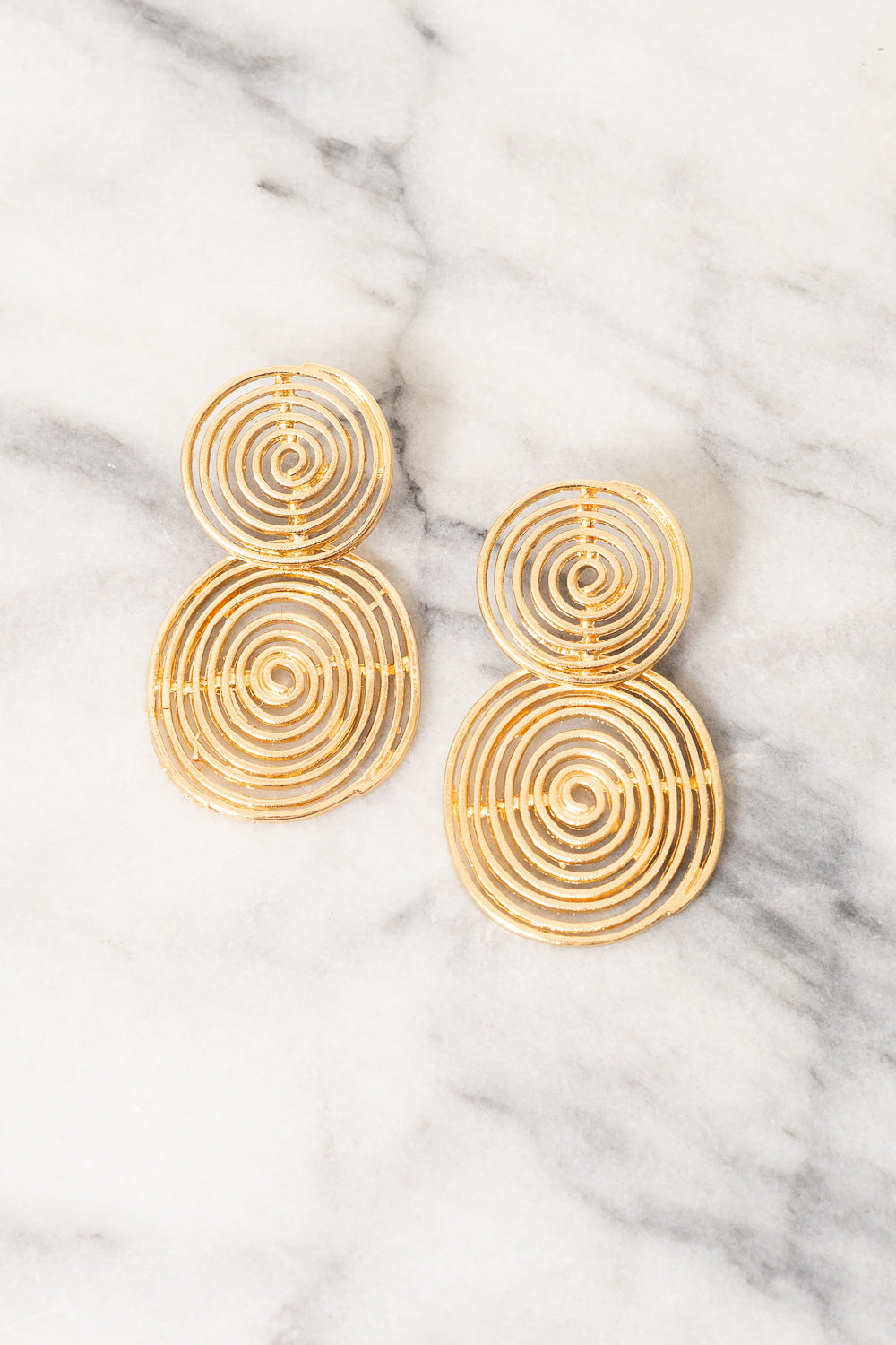 gold sculptural chandelier earrings by janna conner