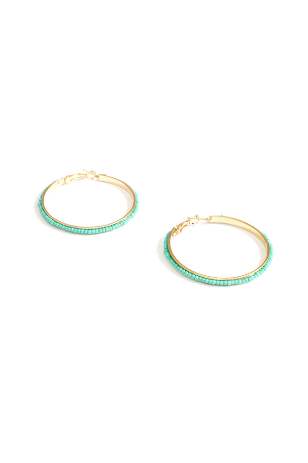 janna Conner turquoise beaded hoop earrings on white background