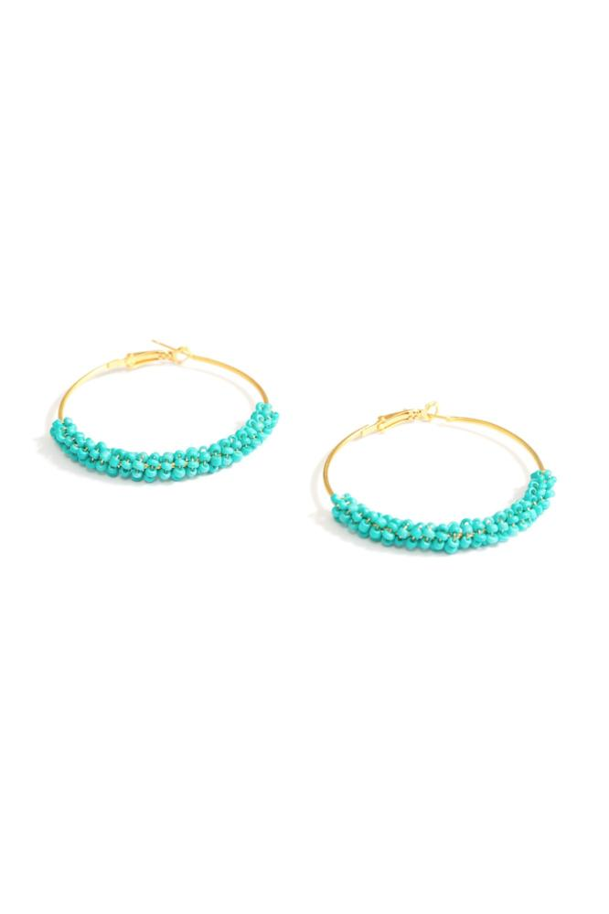 turquoise beaded hoop earrings by janna Conner side view on white background