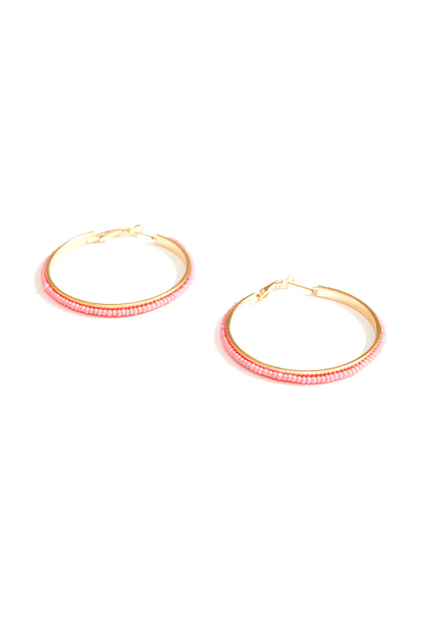 salmon coral beaded hoop earrings by janna Conner on white background