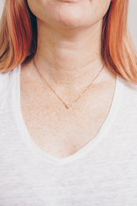 rose gold heart necklace on model