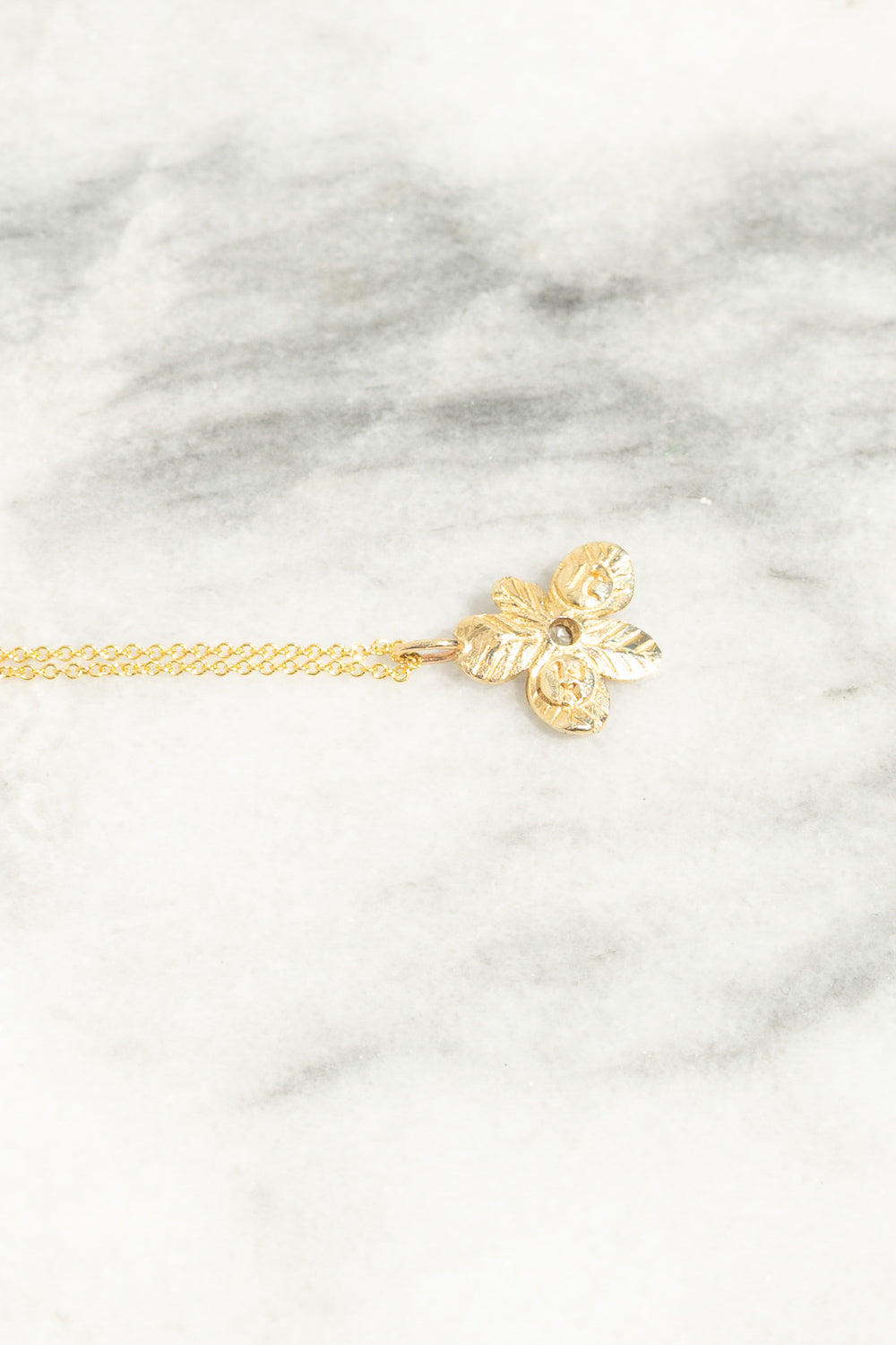 back view of gold flower charm pendant necklace