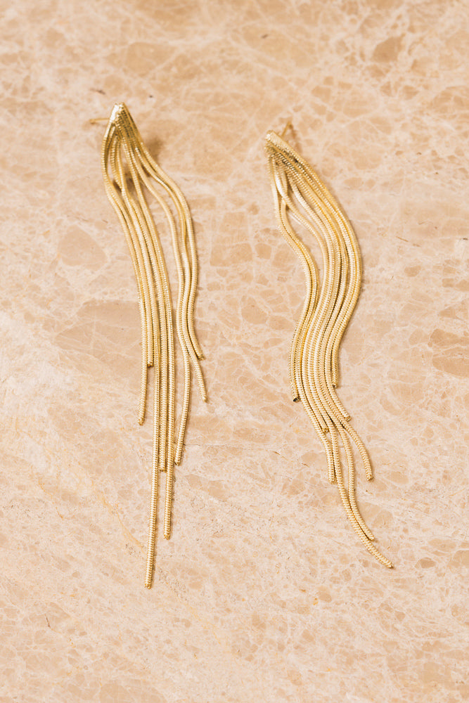 gold chain fringe earrings above view