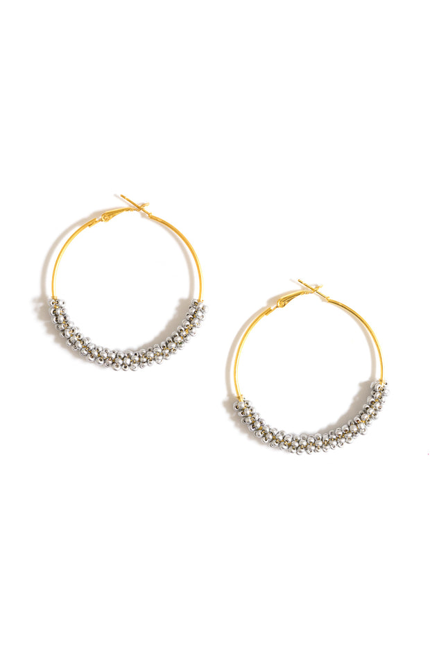 silver wire wrapped beaded hoop earrings by janna conner