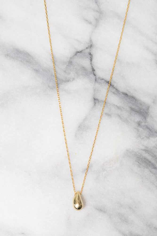 gold droplet pendant on chain necklace