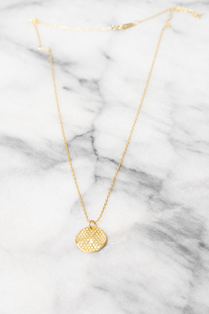 gold perforated disc charm necklace