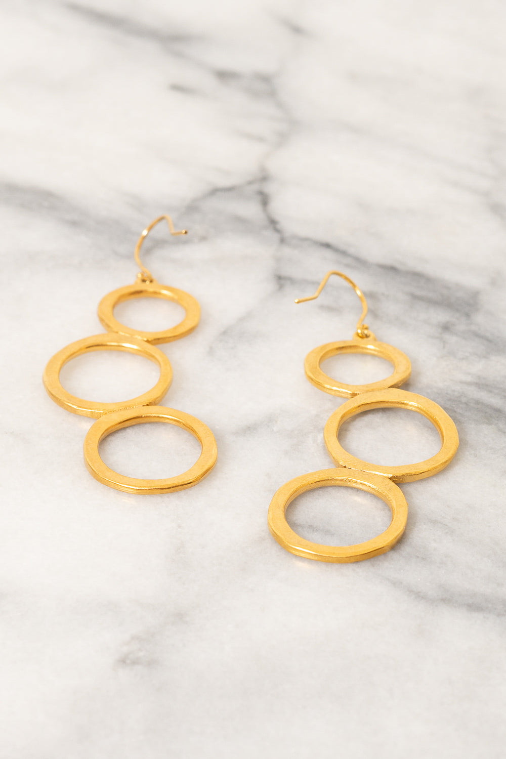 gold circle dangle earrings Janna Conner