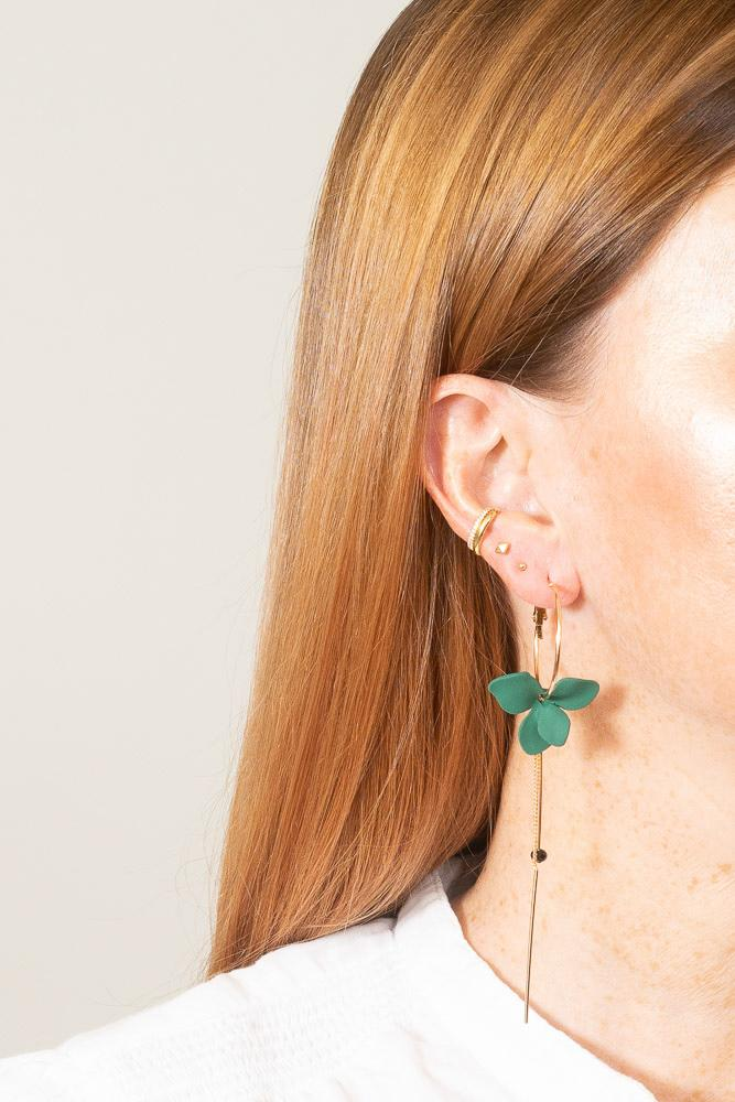 green flower mismatched hoop earrings on model