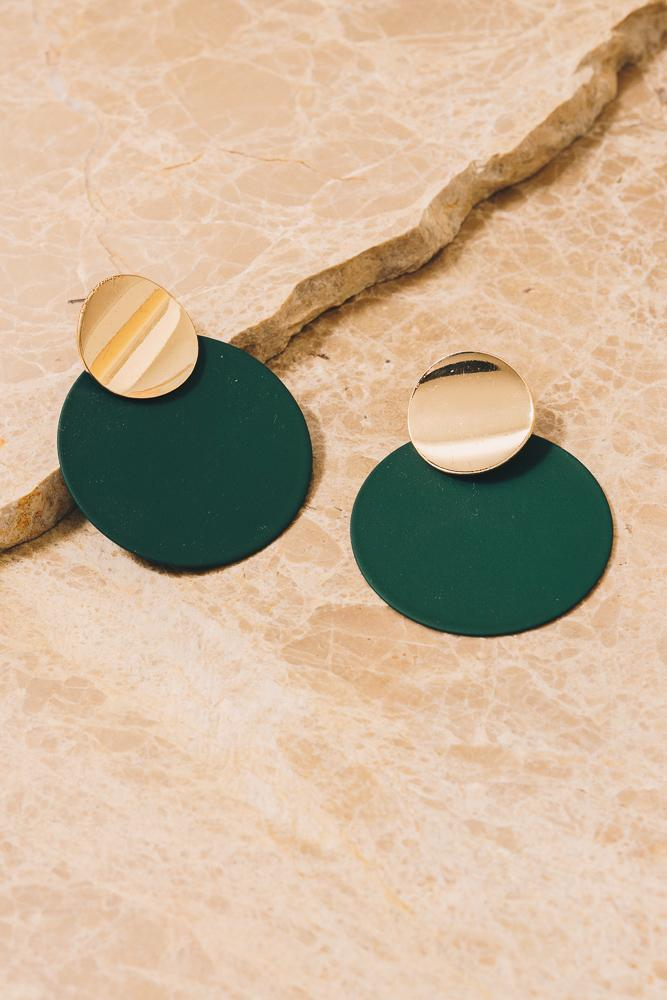 green disc earrings with gold accents