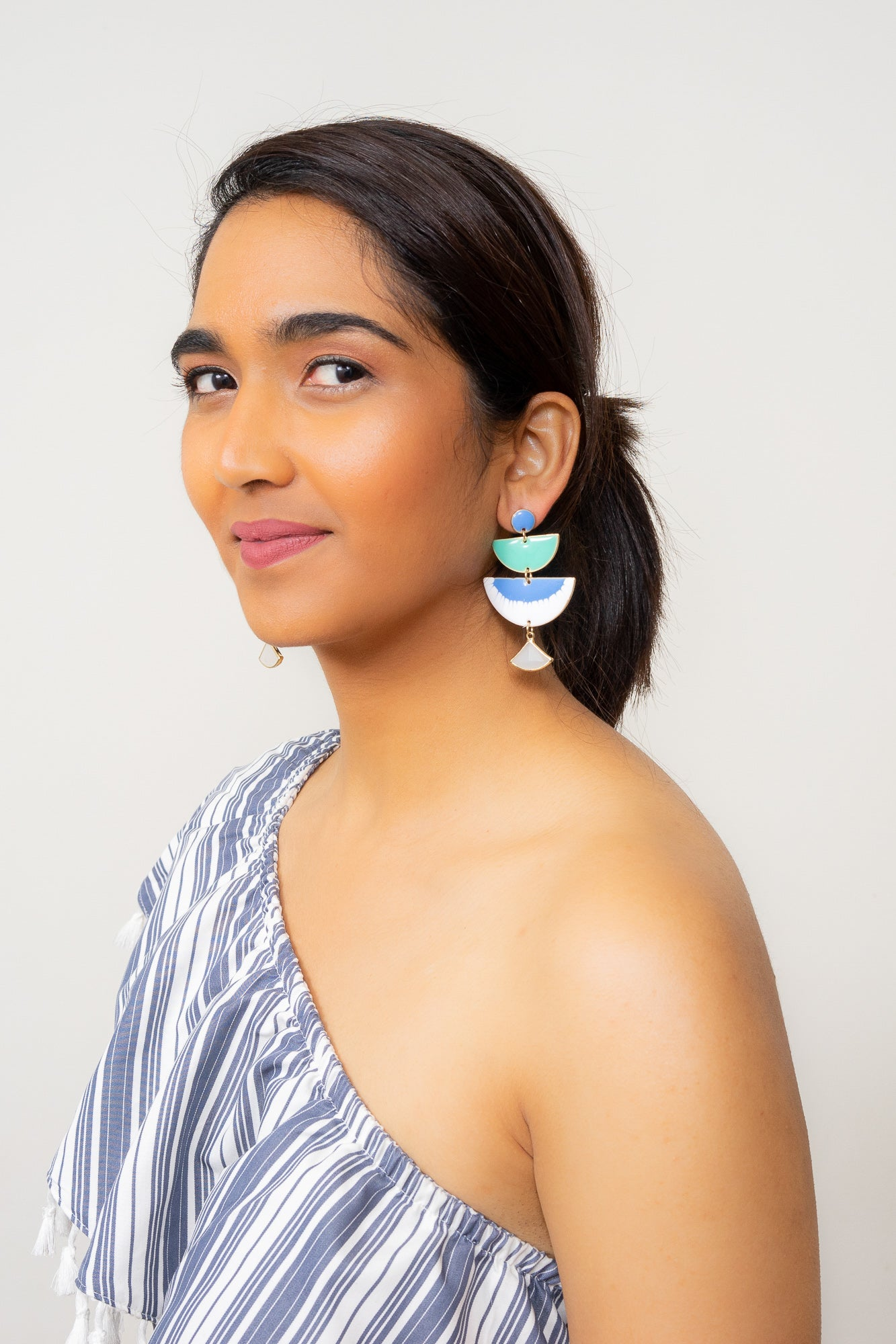 blue green enamel chandelier earrings statement earrings by Janna Conner on model