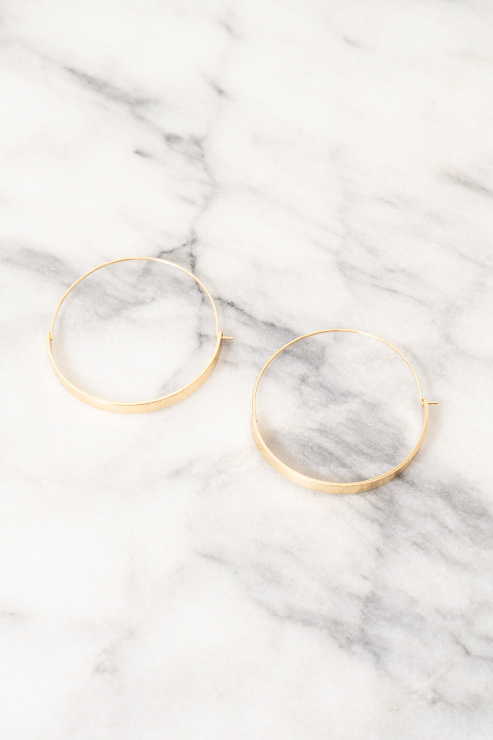 gold wire hoop earrings by Janna Conner