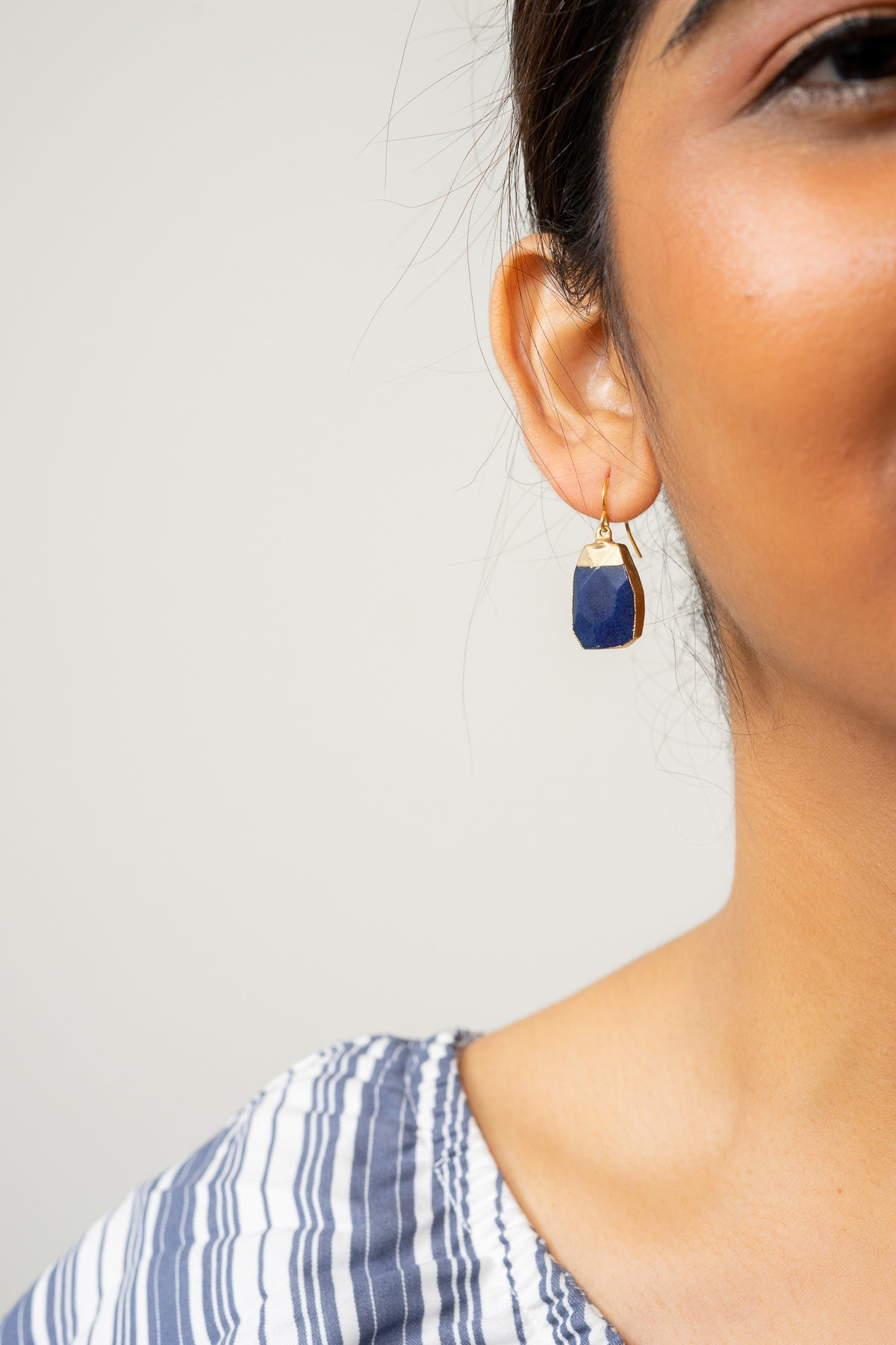 dark blue jade dangle earrings on model