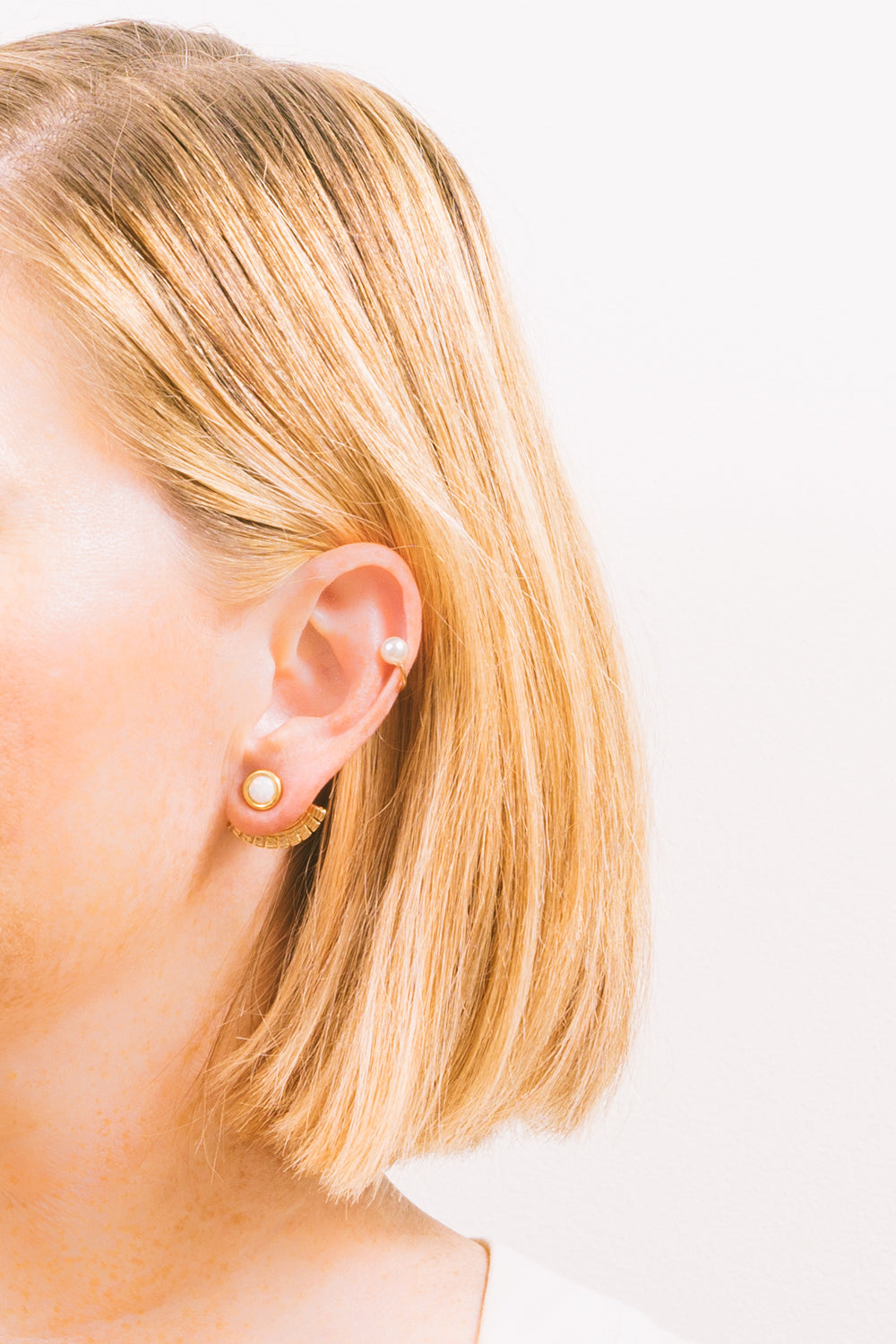 pearl gold ear cuff earrings on model