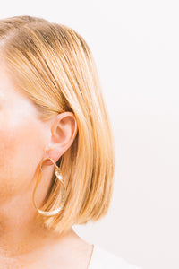 twisted metal earrings on blonde model janna conner
