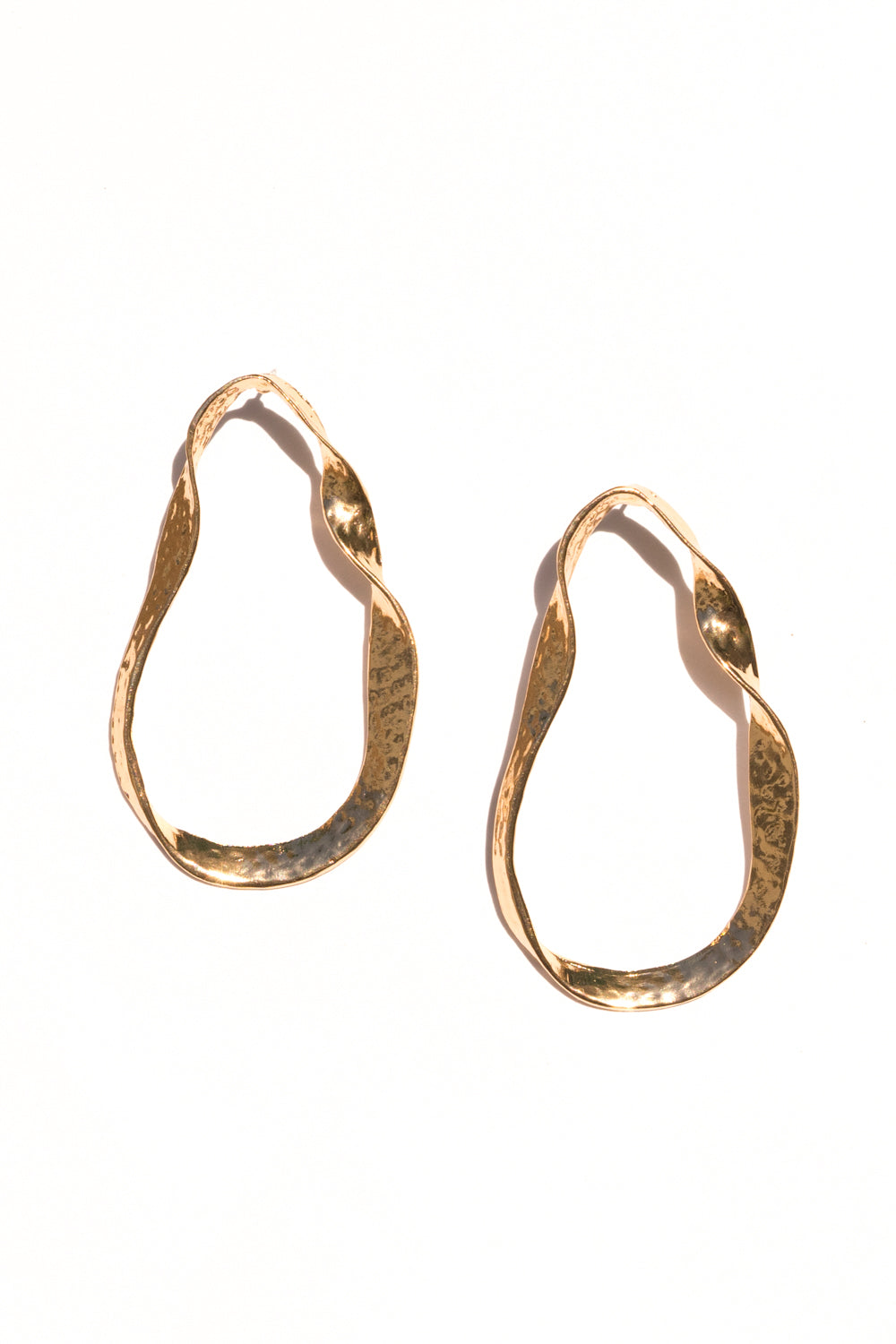 twisted gold metal earrings janna conner