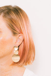 gold disc chandelier earrings on pink haired model