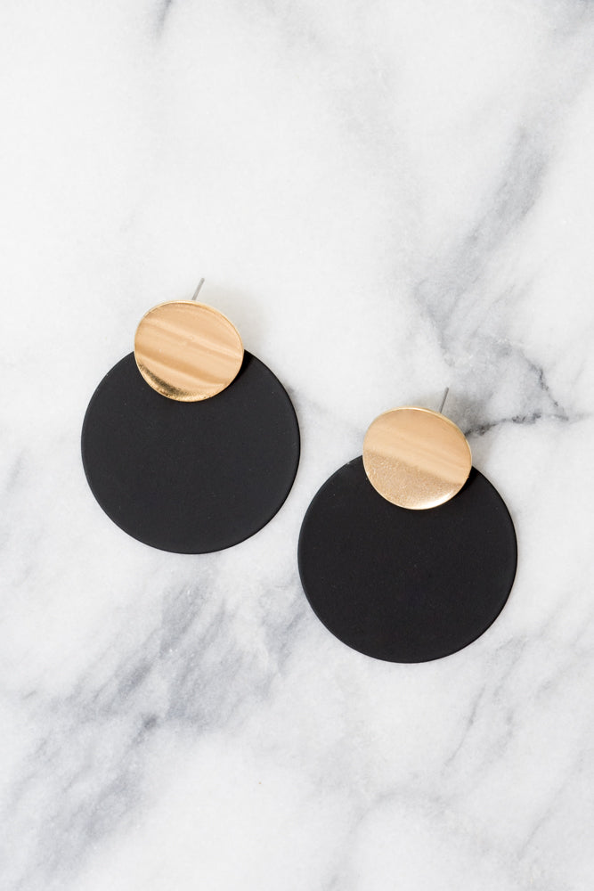 black disc earrings with gold accents