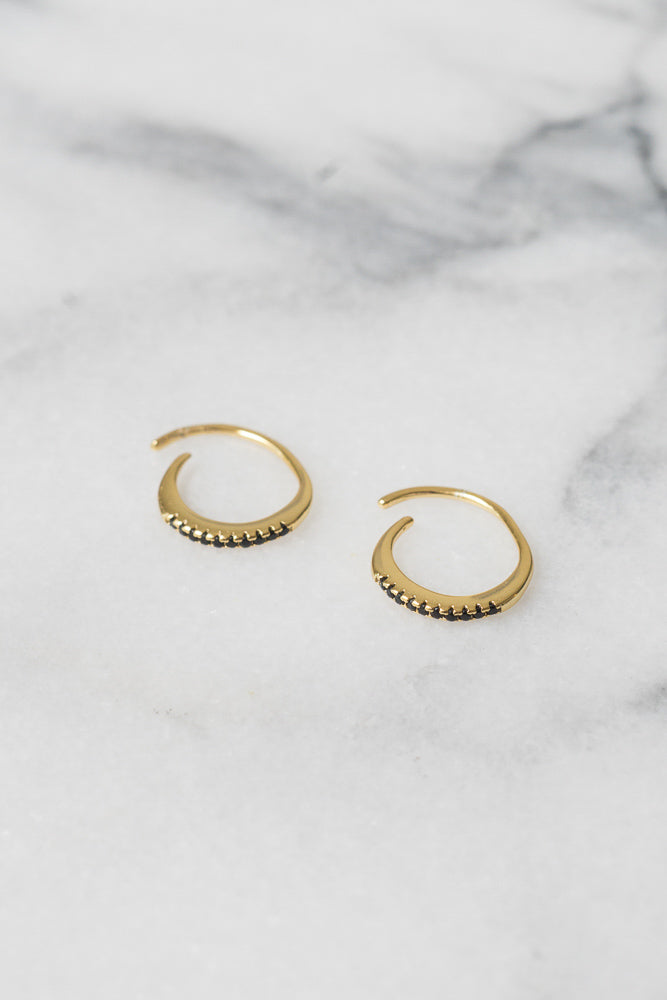 gold hoop earrings with black c.z.