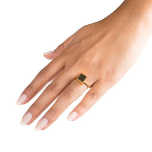gold cube stacking ring on hand