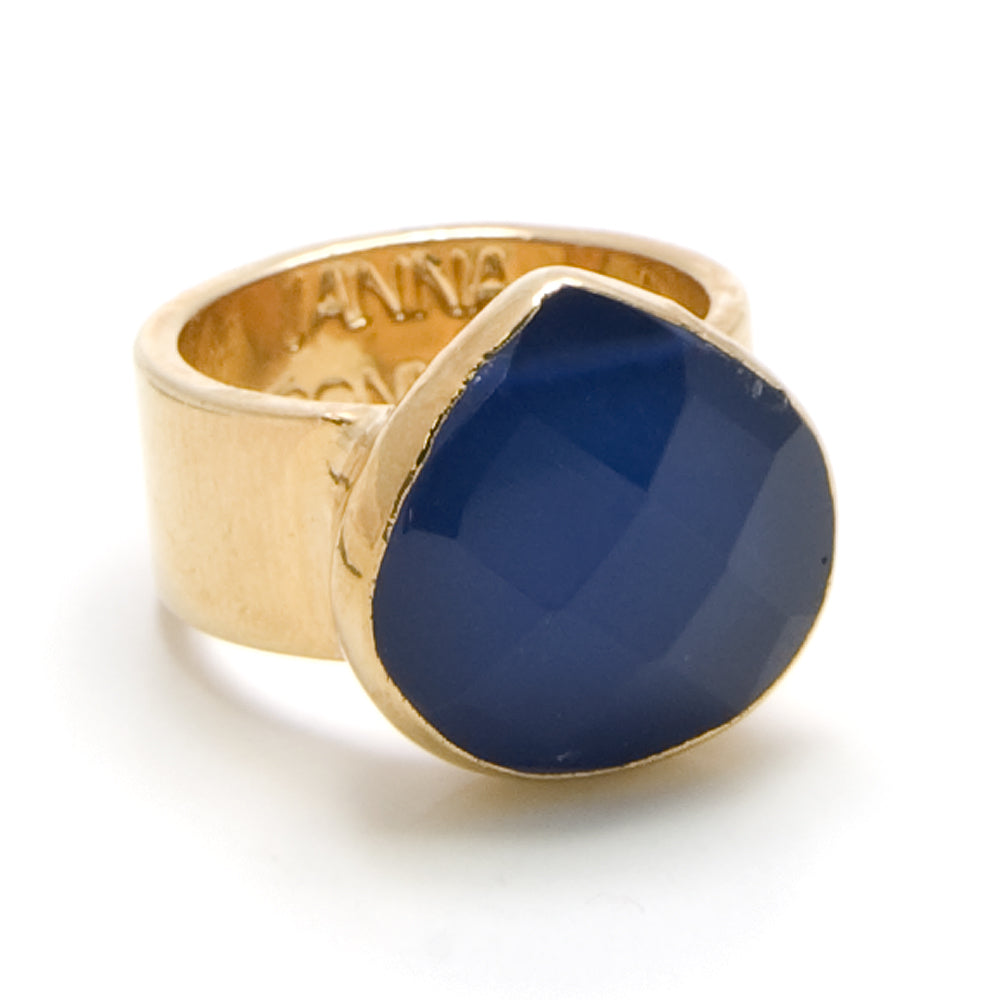 blue pear shaped stone on gold ring band