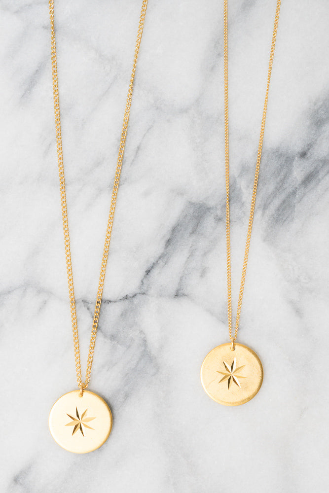 gold starburst coin charm necklaces