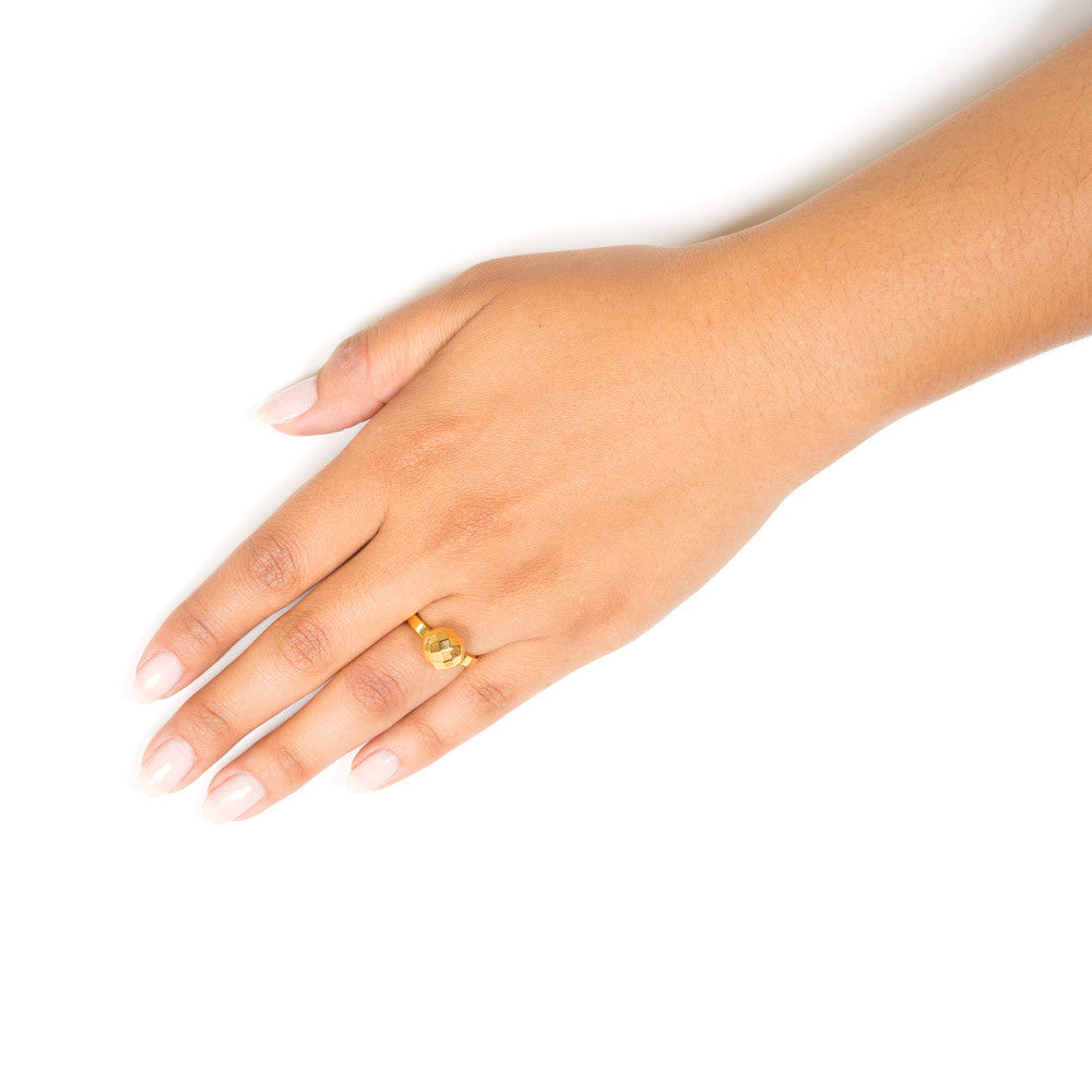 gold ball ring on model hand