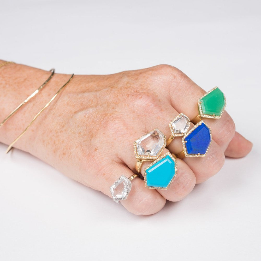 sleeping beauty turquoise lapis chrysoprase and white topaz cocktail rings on hand model gold bangles Janna Conner