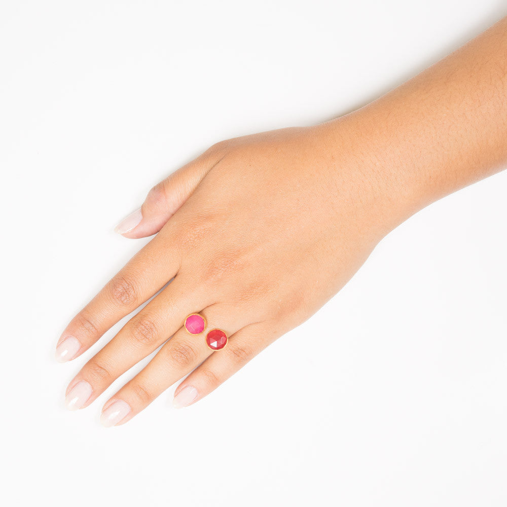 pink and red circle stone open ring on hand
