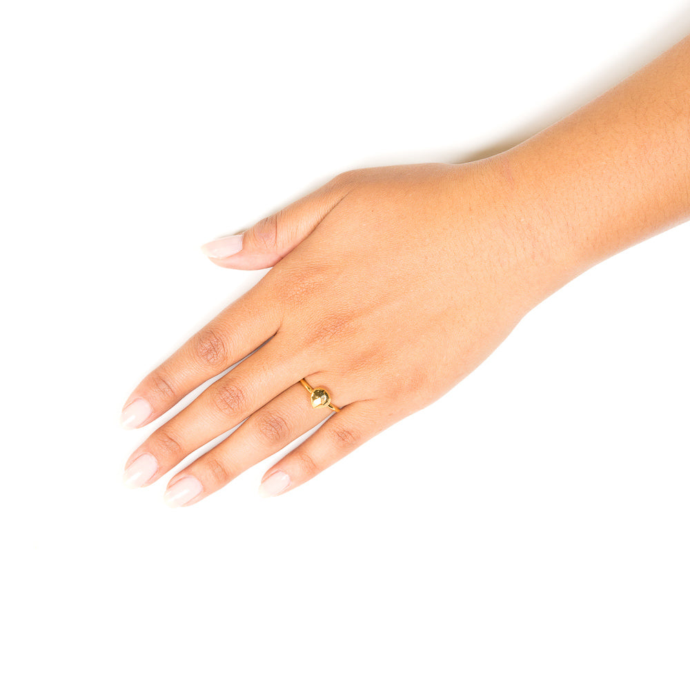gold stacking ring on hand
